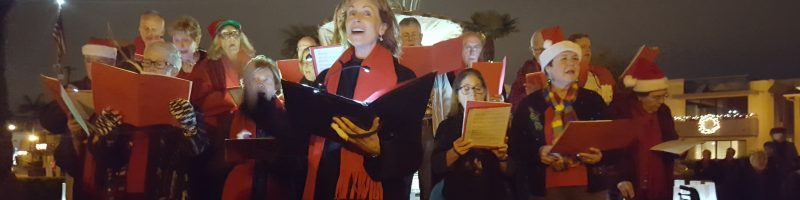 Bayshore Church Christmas carolers at fountain in Naples, CA