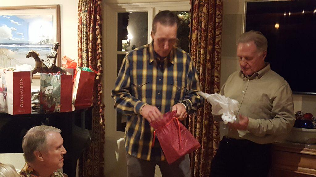 Bay Shore Church Fellowship Club opening white elephant gifts.