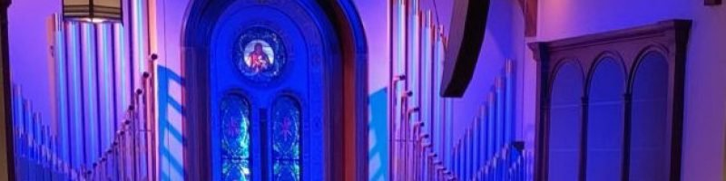 Blue-lit sanctuary organ pipes at Bay Shore Community Congregational Church (UCC) in Long Beach, California